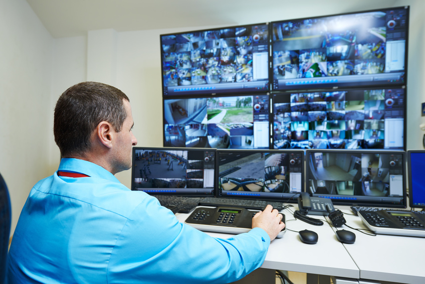 security guard watching video monitoring surveillance security